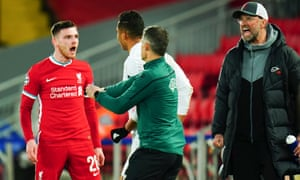 Andrew Robertson (left) and Jurgen Klopp (right) share their opinion with Casemiro of Real Madrid.