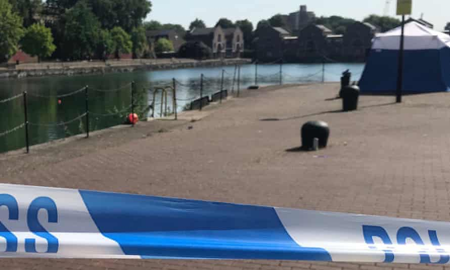 A police cordon at Shadwell Basin in east London, where a man's body was recovered from the water.