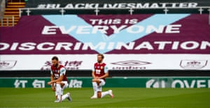 Banners on display at Turf Moor in July.