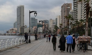 Citizens promenade on the seafront of the Mediterranean coast in Beirut during the curfew imposed by the government to fight the spread of the coronavirus.