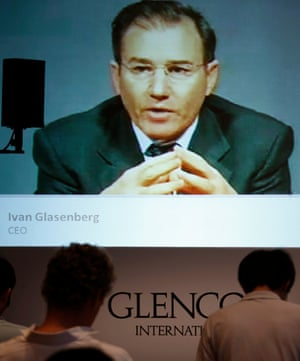Journalists listen as Glencore CEO Ivan Glasenberg is broadcast on a screen during a teleconference in Hong Kong, in 2011.
