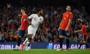 Nacho looks rueful as Raheem Sterling  celebrates after scoring England's third goal