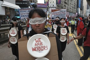 Hong Kong, China. Migrant workers, including construction workers, bus drivers, freelancers and domestic staff from the Philippines and Indonesia, join locals on a Labour Day march through central Hong Kong