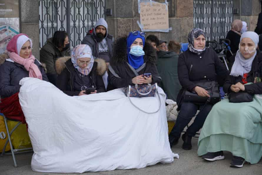Syrian refugees react to Denmark's decision to repatriate with a sit-in in front Denmark's parliament building
