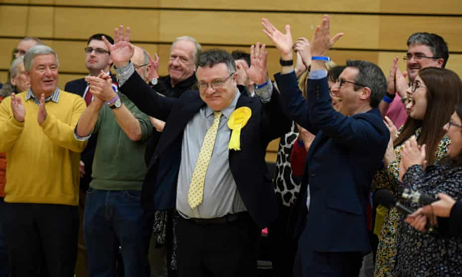 Stephen Farry of the Alliance Party celebrates with supporters after he won the North Down constituency, Bangor, Northern Ireland