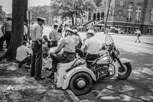 A group of policemen across the street from the 16th Street Baptist Church in Birmingham Alabama