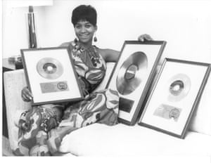 Posing with sales awards discs in 1969