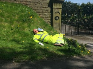 LancashireA road worker takes a nap in the sun during his lunchbreak