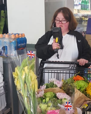 Emily at her part-time job at Booths supermarket.