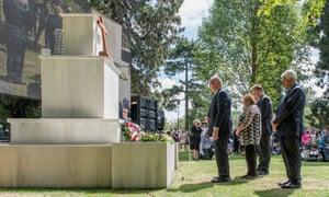 Dignitaries lay a wreath during a civic memorial service held in the botanic gardens for victims of the 2011 Christchurch earthquake.
