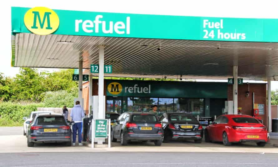 Cars queue for fuel at a Morrisons petrol station