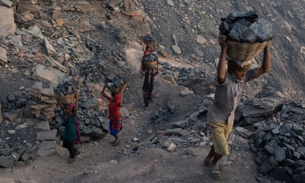 Villagers carry coal that has been scavenged illegally at one of Jharia's many state-owned coal mines