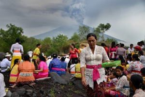 Balinese Hindus take part in a ceremony, where they pray near Mount Agung in hope of preventing a volcanic eruption.