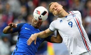 Iceland's Kolbeinn Sigthorsson pressuring Patrice Evra.