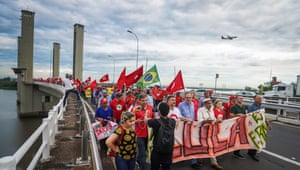 Protesters in Porto Alegre, southern Brazil, rally in support of the former president on 21 January.