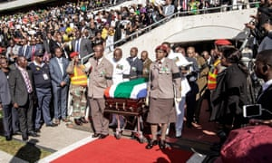 South African military personnel bring in the coffin at Orlando Stadium in Soweto for the funeral ceremony of Winnie Madikizela-Mandela