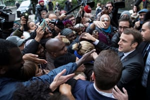 Paris, FrancePresident Emmanuel Macron shakes shakes hands with local residents after visiting a branch of charity food distribution organisation Les Restos du Coeur