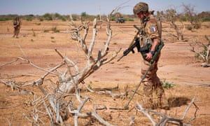 A French soldier searches for explosives in neighbouring Burkina Faso last month, where extremist groups have also increased their presence.