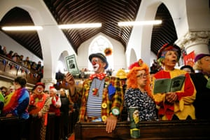 Clowns and entertainers gather to attend an annual service of remembrance in honour of British clown Joseph Grimaldi in Haggerston, London.