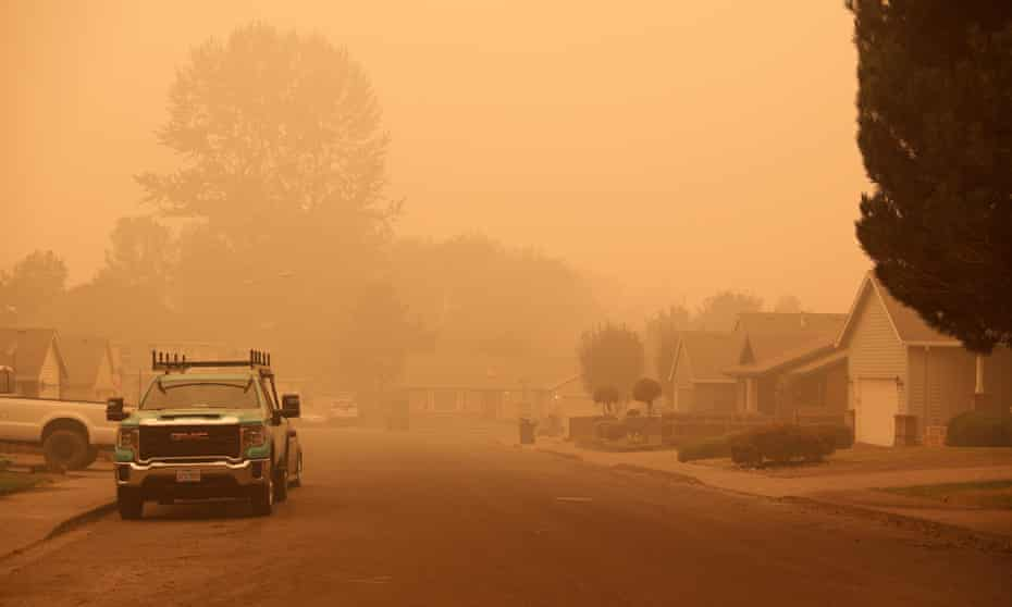 An orange smoke-filled sky is seen above Molalla, Oregon, on Thursday as fires burn nearby.