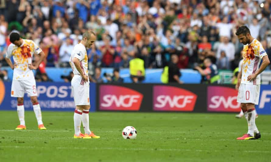Spain's players look dejected after Italy's second goal.