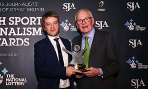 Daniel Taylor receives the sports writer of the year award from SJA president Patrick Collins.
