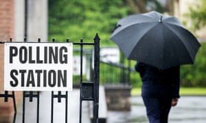 A voter arrives at the polling station in St Nicolas Parish Hall, Belfast