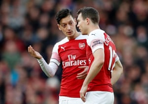 Mesut Ozil offers some advice to Stephan Lichtsteiner.