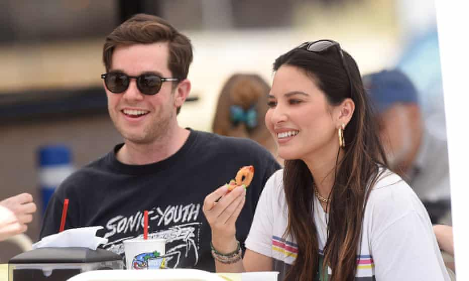 Me, her and me: comedian John Mulaney with actor Olivia Munn earlier this summer.