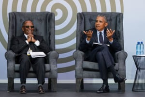 Former US President Barack Obama and the Chancellor of the University of Johannesburg, Professor Njabulo Ndebele, attend the 2018 Nelson Mandela Annual Lecture at the Wanderers cricket stadium