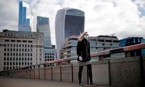 A woman walks across London Bridge