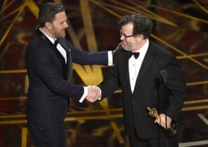 Ben Affleck congratulates Kenneth Lonergan for the award for best original screenplay for Manchester by the Sea.