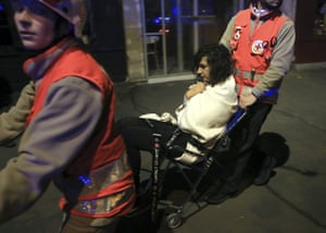 A woman being evacuated from the Bataclan