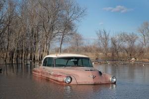 A vintage car sits in flood water in Hamburg, Iowa, US