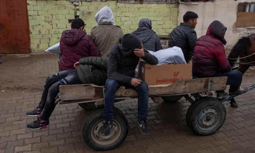 Migrants travel on a horse cart in Edirne, Turkey, near its border crossing with Kastanies in Greece.