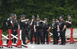 Police gather to patrol a checkpoint in St Ives