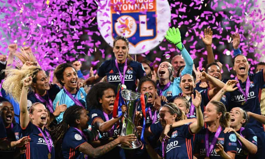 Bronze (bottom right) celebrates with her Lyon teammates after the French club won the Champions League in 2018.