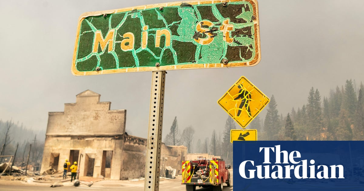 Wildfire tears through northern California gold rush town – video