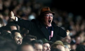 A Fulham fan cheers his team on during the win against Leeds
