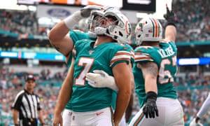 Dolphins kicker Jason Sanders celebrates his touchdown catch against the Eagles