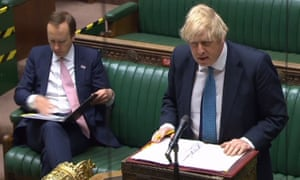 Boris Johnson (R) and Matt Hancock during prime minister's questions in the Commons.
