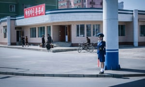 A traffic policewoman stands by an intersection in Pyongyang, North Korea.