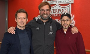 Jürgen Klopp (centre) with the sporting director, Michael Edwards (left), and the FSG president, Mike Gordon, after the Liverpool manager signed a contract extension in December 2019.