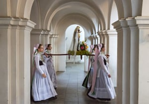 Women from the Slavic-minority Sorbian community, dressed in traditional clothes, carry a statue of the Virgin Mary in a ceremony to mark Whit Monday