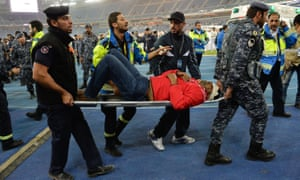 A man injured in the incident at the Jabar International stadium is carried to an ambulance