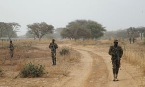 Nigerian soldiers on patrol in the central state of Niger