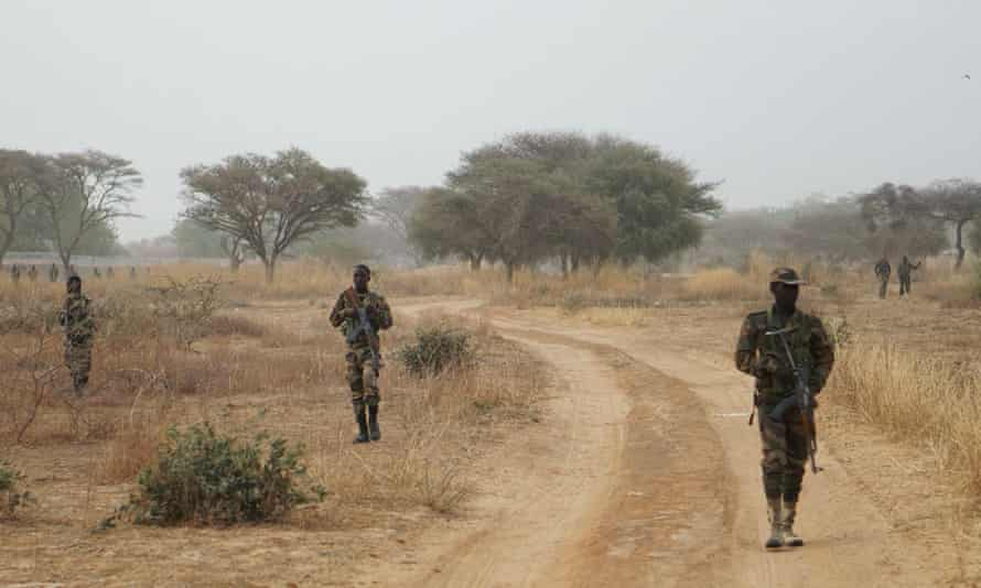 Nigerien troops patrol as part of a joint military exercise with US troops in Diffa, Niger, earlier this year.
