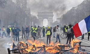 Gilets jaunes protesters set up a barricade on the Champs-Elysees in March.