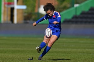 France's fly-half Caroline Drouin kicks the penalty.