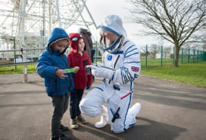 """Two boys with """"spaceman"""" at Jodrell Bank discovery-centre"""